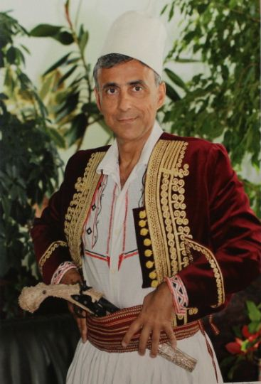 Former EU Ambassador Ettore Sequi in traditional Albanian clothes photographed by Roland Tasho.