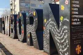 Kosovo's 'NEWBORN' Sign Repainted to Honour Victims of Wartime Sexual Violence