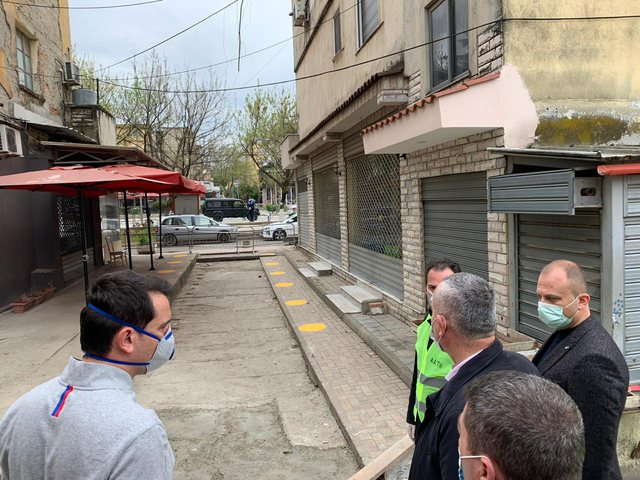 Municipality of Tirana Sprays Shoppers with Disinfectant in Kombinat